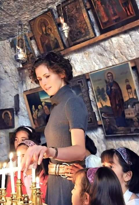 Syria Asma al-Assad lights at a candle at Christian shrine